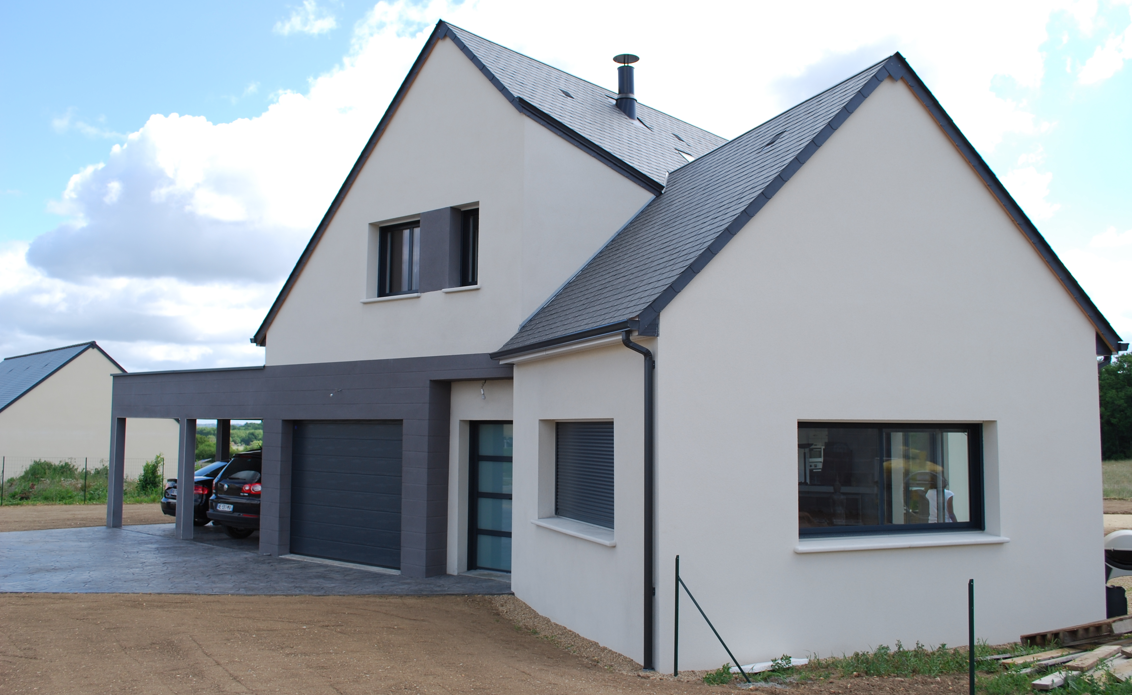 Une maison ericlor r compens e par le concours le b ton - Maison grise et blanche ...